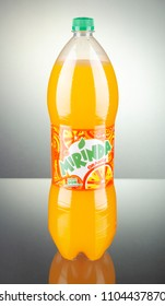 KWIDZYN, POLAND – MARCH 27, 2018: Bottle of Mirinda drink on gradient background. Mirinda is a soft drink created in Spain. Mirinda has been owned by PepsiCo since 1970