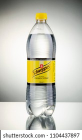 KWIDZYN, POLAND - MARCH 27, 2018: Bottle of Schweppes indian tonic isolated gradient background. Schweppes is a beverage brand including carbonated waters. Schweppes Company was founded in Geneva