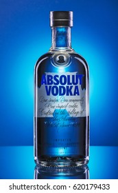 KWIDZYN, POLAND - MARCH 29, 2017: Absolut vodka on blue background. Absolut vodka has been produced in southern Sweden since 1879. Absolut was bought by Pernod Ricard group in 2008