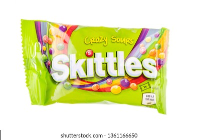 KWIDZYN, POLAND – OCTOBER 27, 2018: Skittles fruit-flavoured candies isolated on white background. Nowadays Skittles produced and marketed by the Wrigley Company Wrigley Company a division of Mars Inc