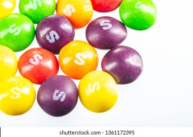 KWIDZYN, POLAND – OCTOBER 28, 2018: Skittles fruit-flavoured candies isolated on white background. Nowadays Skittles produced and marketed by the Wrigley Company Wrigley Company a division of Mars Inc
