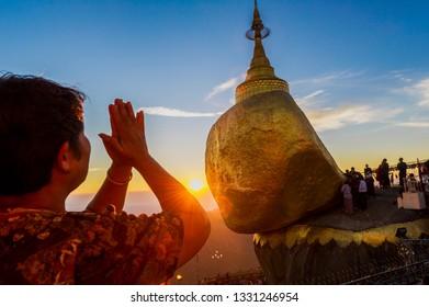 Kyaiktiyo. Myanmar. 12/12/2016. Sacred site of the golden rock. Woman praying