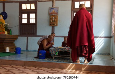 KYAUKME, MYANMAR - FEB 21, 2015 - Buddhist monks eating their main meal of the day at noon, Kyaukme Myanmar (Burma)