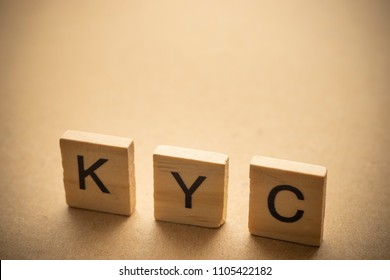 KYC on wood. Know Your Customer concept