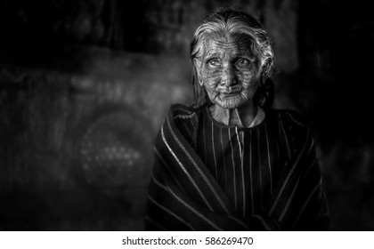 Kyee Chaung, Myanmar -Dec 25, 2016: Portrait of old woman with facial tattoos in Chin villages, Mrauk U region,Arakan