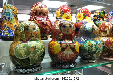 Kyiv, Ukraine–May 18, 2019: Traditional russian dolls figures, ethno gift shop. Russian Matryoshka Dolls for sale. brightly painted hollow wooden dolls of varying sizes, designed to nest inside
