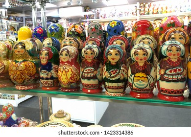 Kyiv, Ukraine–May 18, 2019: Ukrainian traditional nesting dolls stand on the showcase of a gift shop. lot of Matryoshka at souvenir market shop. Famous classical and modern ukrainian Matrioshka toys