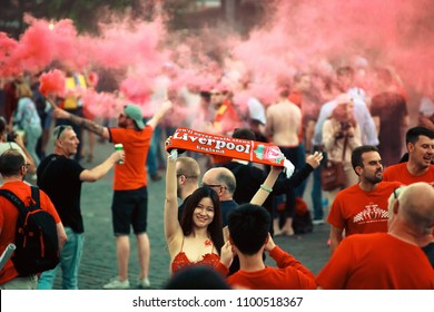 KYIV, UKRAINE—MAY 26, 2018: UEFA Champions League in Kiev Finale Young woman group fan Liverpool FC supporters before the UEFA champions' league match betwen Real Madrid and Liverpool.