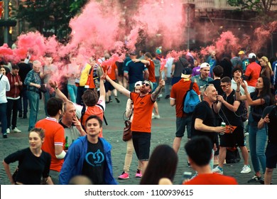KYIV, UKRAINE—MAY 26, 2018: UEFA Champions League Finale in Kiev  group of fans burn flares Liverpool FC supporters before the UEFA champions' league match betwen Real Madrid and Liverpool.