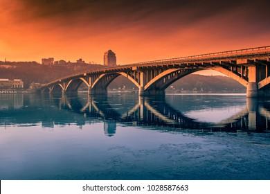 Kyiv beautiful evening view on Merto Bridge, winter sunrise, evening view on Dnieper River, Ukraine