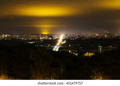 Kyiv city and Dnipro river, bridge, after sunset night view