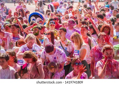 """Kyiv Euro Marathon Ukraine, Kyiv - June 2, 2019: Festival of colors Holi. A large crowd of people with stained faces stands near the stage. Soiled in multicolored powder. """"Kyiv Color Run"""" - fan compet"""
