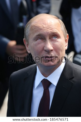 KYIV - JUL 27: President of Russia Vladimir Putin attend a ceremony marking the 1,025th anniversary of the Christianization of Kievan Rus in Kiev, Ukraine. July 27, 2013.