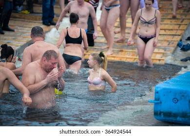 KYIV (Kiev) - 01.19. 2016: Epiphany near Svjato-Pokrovskiy Cathedral on January in Kyiv. People plunging into ice-cold water as it helps body became resilient to illness.Epiphany known since 988 AD.