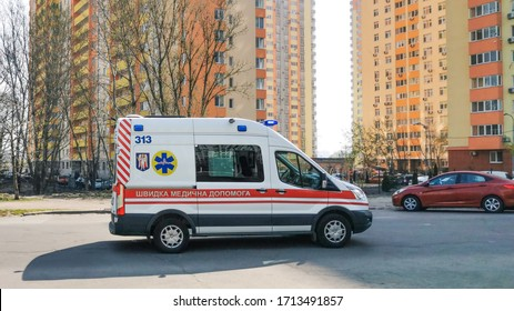 KYIV, KIEV / UKRAINE - April 17, 2020: ambulance that rides on call in a stream of cars. The concept of medicine, panovirus coronavirus COVID-19 and various diseases, medical transport.