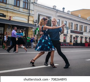 KYIV (KIEV), UKRAINE - SEPTEMBER 3, 2017 - waltz walk in city center: two young couples dancing in the street