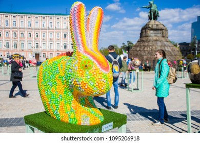 KYIV (KIEV), UKRAINE-APRIL 20, 2018: The figure of a rabbit or hare in the guise of the chameleon against the background of monument to Bohdan Khmelnytskyi. Beautiful Easter decoration art