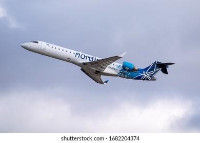 Kyiv Region, Ukraine - October 1, 2019: Nordica Bombardier CRJ-701ER is taking off into flight