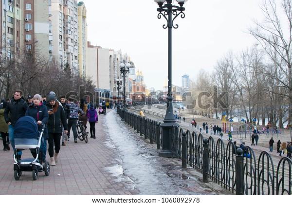 Kyiv, Ukraine - 01, April, 2018: Obolonskaya embankment with walking people in the spring