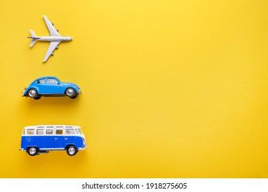 Kyiv, Ukraine - 02.01.2021 Toy Lufthansa plane, Volkswagen car and Volkswagen van on a yellow background. Travel and ticketing concept.