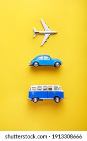 Kyiv, Ukraine - 02.01.2021 Toy plane, Volkswagen car and Volkswagen van on a yellow background. Travel and ticketing concept.