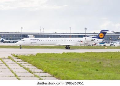 Kyiv, Ukraine - 04.06.2021: A Lufthansa Cityline Bombardier CRJ900 plane lands at the airport in the capital of Ukraine - Boryspil. Day, sunny. Summer.