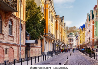Kyiv / Ukraine - 04.07.2019: people are walking along Vozdvizhenka lane that is the part of old district Podol in Kyiv, Ukraine.