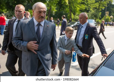 KYIV, UKRAINE - 08 JUNE 2014: The President of Belarus Alexander Lukashenko with youngest son visit the inauguration of Ukrainian President Petro Poroshenko. June 08, 2014 in Kyiv, Ukraine