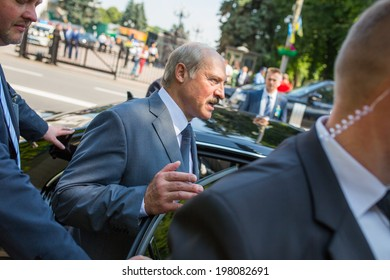 KYIV, UKRAINE - 08 JUNE 2014: The President of Belarus Alexander Lukashenko gets into the car visit the inauguration of Ukrainian President Petro Poroshenko. June 08, 2014 in Kyiv, Ukraine