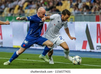 Kyiv, UKRAINE - 14 August, 2018: Josip Pivaric of Dynamo Kyiv in fight the ball with Miroslav Stoch of SK Slavia during the Qualifiyng UEFA Champions League match at NSC Olimpiyskiy
