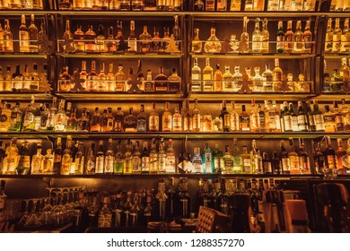 KYIV, UKRAINE - 15 JAN: Huge wall of bar with whisky bottles, rum, gin, vodka for dtrong drink lovers on January 15, 2019. Population of Kiev is near 3,000,000