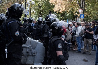 Kyiv / Ukraine - 17.09.2018: Ukrainian protesters try to break into the general prosecutor's office of Ukraine. Police in equipment and with shields block their path. Chief prosecutor Yuriy Lutsenko