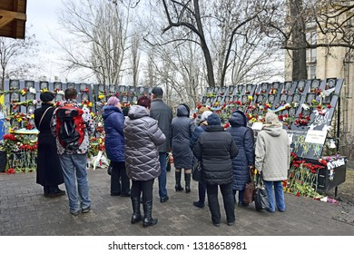 KYIV, UKRAINE- 20 FEBRUARY, 2019: Day of memory for Heroes of  Heavenly Handred. Fifth anniversary of protesters killed by special forces. People look on engraved images of perished activists