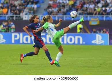 KYIV, UKRAINE – 24 MAY, 2018: Two footballers compete for the ball during the final of the UEFA Women's Champions League VfL Wolfsburg – Lyon at the Valeriy Lobanovskyi Dynamo Stadium