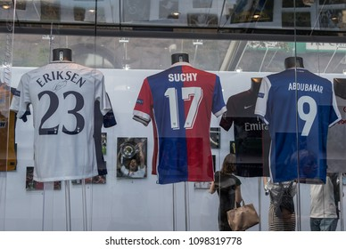 Kyiv, Ukraine - 24 may, 2018:T-shirts of players of all teams participating in the Champions League drawing season 2017/2018 with autographs.T-Shirts Eriksen from Totenhem, Suchy from Basel, Aboubakar