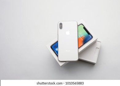 KYIV, UKRAINE - 26 JANUARY, 2018: New Iphone X smartphone model close up. Newest Apple Iphone 10 mobile phone device on white branded Apple box on white table in store.