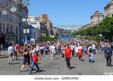KYIV, UKRAINE – 26 MAY, 2018: Fans of FC Liverpool and Real Madrid are strolling before the start UEFA Champions League Final between Liverpool and Real Madrid at Olimpiyskiy National Sports Complex