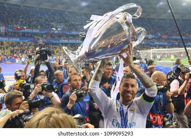 KYIV, UKRAINE – 26 MAY, 2018: Sergio Ramos is in the hands of the Champions Cup during the final match UEFA Champions League between Liverpool and Real Madrid