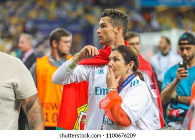 KYIV, UKRAINE – 26 MAY, 2018: Portuguese professional footballer Cristiano Ronaldo with his mother during the final match UEFA Champions League between Liverpool and Real Madrid