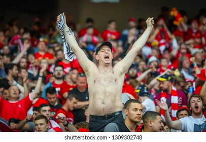 KYIV, UKRAINE – 26 MAY, 2018: Liverpool's fan is on the podium among British fans during the final match UEFA Champions League between Liverpool and Real Madrid