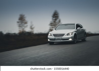 Kyiv, Ukraine - 26 October 2019: Car Lexus LS460 on road. Silver car. Front view of the car.