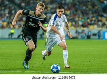 Kyiv, UKRAINE - 28 August, 2018: Benjamin Verbic of Dynamo Kyiv in fight the ball with Matthijs de Ligt of Ajax during the Qualifying UEFA Champions League match at NSC Olimpiyskiy
