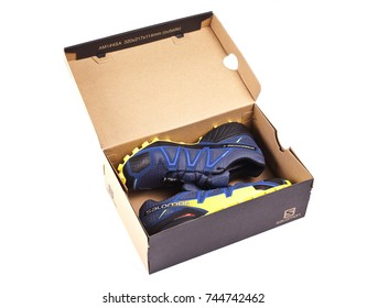 Kyiv, Ukraine, 28 October 2017- Salomon Speedcross 4 GTX sports shoes on white background. The Salomon Group is a famous sports equipment manufacturing company.