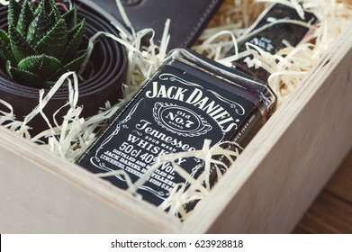 KYIV, UKRAINE - APRIL 01, 2017: Bottle of Jack Daniel's in wooden gift box with succulent.