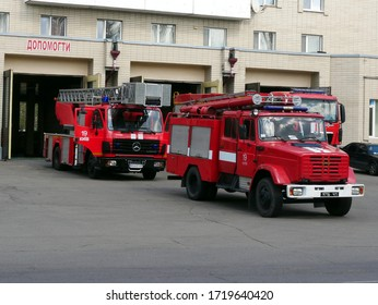 Kyiv, Ukraine - April 04 2020: Red fire engines standing at the fire station during the day.
