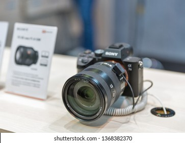 KYIV, UKRAINE - APRIL 06, 2019: Professional photographic camera Sony Alpha a7 III closeup on company booth during CEE 2019, the largest consumer electronics trade show of Ukraine in Tetra Pack EC.