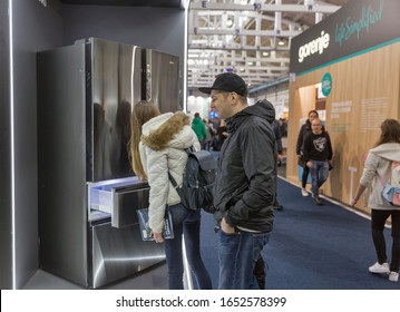 KYIV, UKRAINE - APRIL 13, 2019: People visit Haier booth, a multinational home appliances and consumer electronics company, at CEE 2019, the largest electronics trade show of Ukraine in Tetra Pack EC.