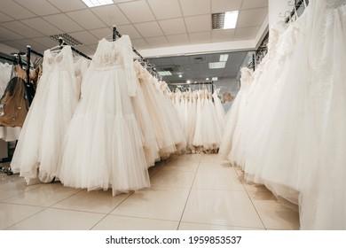Kyiv, UKRAINE - April 15, 2021: Wedding dresses in bridal salon in mall