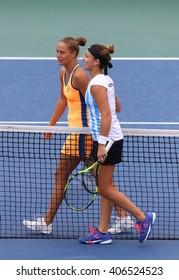 KYIV, UKRAINE - APRIL 16, 2016: Kateryna Bondarenko of Ukraine (L) reacts after won the BNP Paribas FedCup match against Maria Irigoyen of Argentina at Campa Bucha Tennis Club in Kyiv, Ukraine