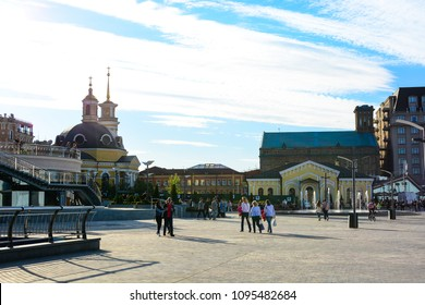 Kyiv, Ukraine - April 18, 2017: People walking at the Kyiv River Port. Church of the Nativity of Christ. Panorama of Kyiv, Ukraine.